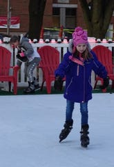 Brooklyn Kuhn, 8, is one of the first to check out the FCBank Ice Skating Rink on Washington Square on Friday evening. The portable rink uses no ice.