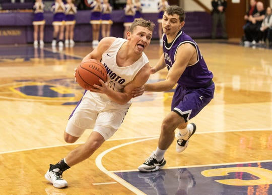 Unioto junior Isaac Little drives past Logan Friday Night at Unioto High School.