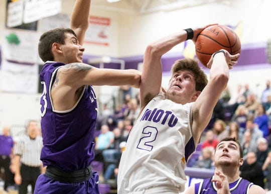 Unioto junior Cameron DeBord puts up a shot against Logan Friday night at Unioto High School. Unioto defeated Logan 56-47.