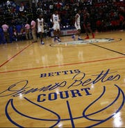Woodward High School basketball takes to floor at the new named Dennis Bettis Court, before their game against Hughes, Friday, Dec. 6, 2019.