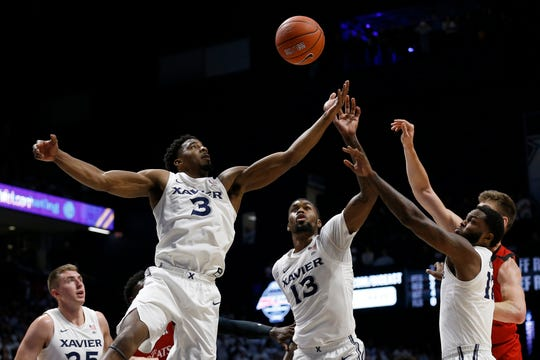 Xavier Musketeers guard Quentin Goodin (3) reaches to pull in a rebound in the first half of the Annual Crosstown Shootout rivalry game between the Xavier Musketeers and the Cincinnati Bearcats at the Cintas Center in Cincinnati on Saturday, Dec. 7, 2019. Xavier had a 32-29 lead at halftime.