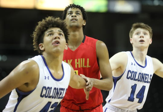 Oak Hill Academy forward Darius Maddox (4) battles Covington Catholic players Chandler Starks and Colin McHale for a rebound during the Griffin Elite Prep School Classic, Saturday, Dec. 7, 2019.