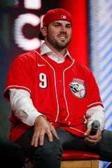 """Cincinnati Reds second baseman Mike Moustakas takes questions from young fans during the """"Kids Only Press Conference"""" during RedsFest at the Duke Energy Convention Center in downtown Cincinnati on Friday, Dec. 6, 2019."""