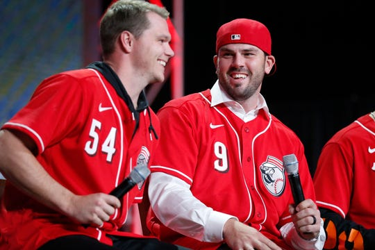 """Cincinnati Reds second baseman Mike Moustakas and pitcher Sonny Gray, who have previously faced off in the American League playoffs before becoming teammates this season, joke during the """"Kids Only Press Conference"""" segment during RedsFest at the Duke Energy Convention Center in downtown Cincinnati on Friday, Dec. 6, 2019."""