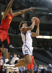 Covington Catholic forward Chandler Starks (42) drives to the basket during the  Griffin Elite Prep School Classic at BB&T Arena, Saturday, Dec. 7, 2019.