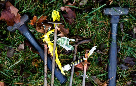 Stakes and hammers lay in the grass to be used to secure items that are part of the Light Up Middletown Christmas light display on Friday, Nov. 22, 2019, in Middletown.