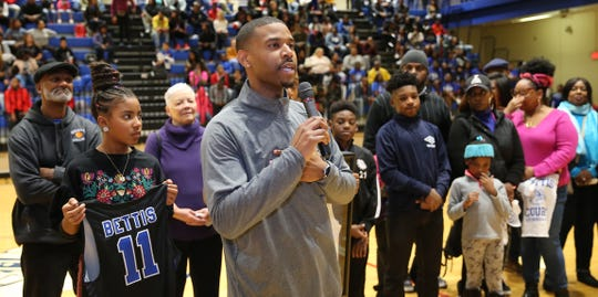 Dominique Bettis speaks during the ceremony at halftime of the Bulldogs game against Hughes to honor his father Dennis Bettis Friday, Dec. 6, 2019.