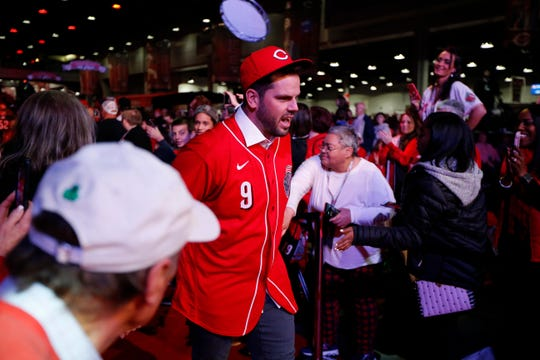 Newly signed Cincinnati Reds second baseman Mike Moustakas takes the main stage during RedsFest at the Duke Energy Convention Center in downtown Cincinnati on Friday, Dec. 6, 2019.