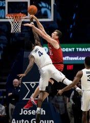 Xavier Musketeers forward Tyrique Jones (4) blocks Cincinnati Bearcats center Chris Vogt (33) in the first half of the NCAA basketball game on Saturday, Dec. 7, 2019, at the Cintas Center in Cincinnati.
