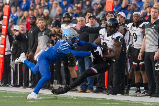Dec 7, 2019; Memphis, TN, USA; Cincinnati Bearcats wide receiver Malick Mbodj (8) catches a pass against Memphis Tigers defensive back Chris Claybrooks (7) during the first half at Liberty Bowl Memorial Stadium. Mandatory Credit: Justin Ford-USA TODAY Sports