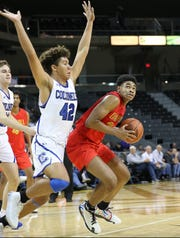 Oak Hill Academy's Cam Thomas (24) drives to the basket against Covington Catholic forward Chandler Starks, during the Griffin Elite Prep School Classic, Saturday, Dec. 7, 2019.