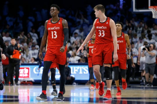 The Cincinnati Bearcats trail after the final buzzer in the first half of the Annual Crosstown Shootout rivalry game between the Xavier Musketeers and the Cincinnati Bearcats at the Cintas Center in Cincinnati on Saturday, Dec. 7, 2019. Xavier had a 32-29 lead at halftime.