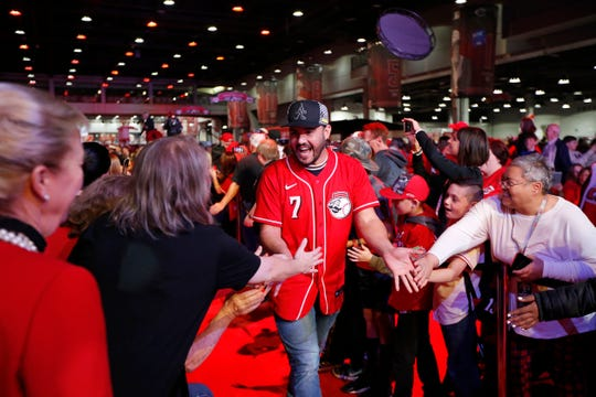 Cincinnati Reds third baseman Eugenio Suarez greets fans as he takes the main stage during RedsFest at the Duke Energy Convention Center in downtown Cincinnati on Friday, Dec. 6, 2019.