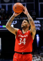Cincinnati Bearcats guard Jarron Cumberland (34) shoots from three point range in the first half of the Annual Crosstown Shootout rivalry game between the Xavier Musketeers and the Cincinnati Bearcats at the Cintas Center in Cincinnati on Saturday, Dec. 7, 2019. Xavier had a 32-29 lead at halftime.