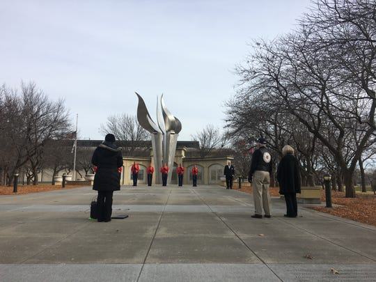 About 50 people gathered at the State Capitol World War II Memorial to remember the lives lost during the Pearl Harbor attacks Saturday afternoon.
