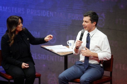 Journalist Leslie Marshall speaks with South Bend, Indiana, mayor and current Democratic presidential candidate hopeful Pete Buttigieg during the Teamsters Presidential Candidate Forum at Veterans Memorial Coliseum in Cedar Rapids on Saturday, Dec. 7, 2019.