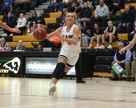 Southeast Polk's Jaycie Elliott (4) drives the lane during their game with Ankeny Centennial in a Dec. 3 game at Southeast Polk won the game 53-44.