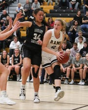 Ankeny Centennial's Alexandria Keahna-Harris (34) defends the pass from Southeast Polk's Brooke Woodyard (42)  in a Dec. 3 game at Southeast Polk won the game 53-44.