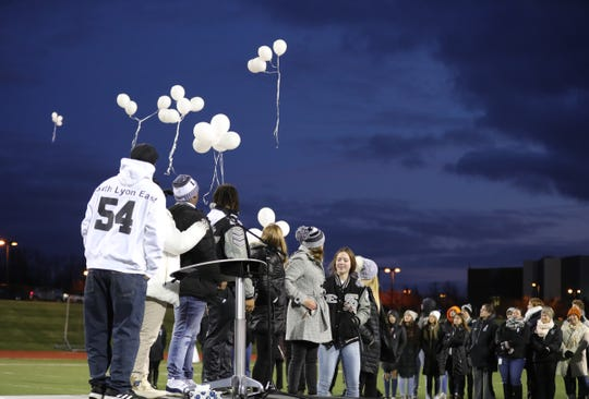 """Students and family members released balloons with """"54"""" written on them during the memorial held to honor Trevon Tyler on Friday, Dec. 6, 2019 at South Lyon East High School in South Lyon, Mich. Tyler wore No. 54."""