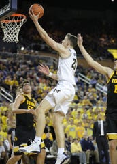 Michigan guard Franz Wagner drives against Iowa center Luka Garza during the second half Friday, Dec. 6, 2019 at the Crisler Center in Ann Arbor.