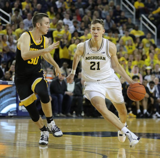 Franz Wagner drives against Iowa's Connor McCaffery during the second half Friday.