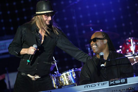 Kid Rock performs with Stevie Wonder at the Motown 50 Golden Gala Live it Again Weekend held in the Renaissance ballroom at the Marriott in the Renaissance Center in Detroit in 2009.