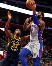 Andre Drummond makes a layup over Pacers center Myles Turner on Friday.