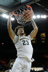 Michigan's Brandon Johns Jr. dunks in the first half against Iowa, Friday, Dec. 6, 2019 at the Crisler Center.
