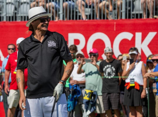 Kid Rock looks on at his drive to the 15th green during the Area 313 Celebrity Challenge during the Rocket Mortgage Classic Tuesday, June 25, 2019 at the Detroit Golf Club.