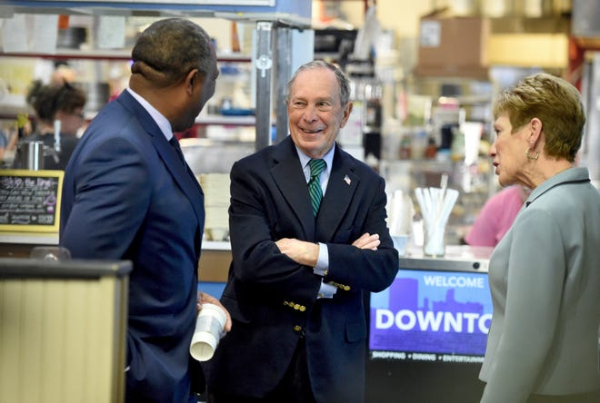 Democratic presidential candidate and former New York Mayor Michael Bloomberg, middle, and Augusta, Ga.