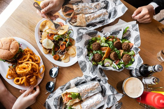 Bucharest Grill offers shawarma sandwiches, burgers, steak, traditional Romanian dishes and vegetarian options like falafel from Wonder Falafel.
