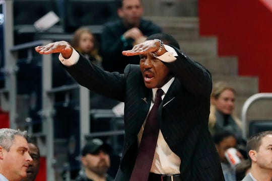 Pistons coach Dwane Casey tries to help his team get over the wall.