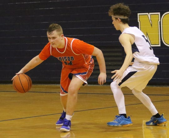 Jack Hourihan handles the ball for Thomas A. Edison as Elmira Notre Dame's Joseph Sheehan defends during boys basketball Dec. 6, 2019 at Notre Dame High School.