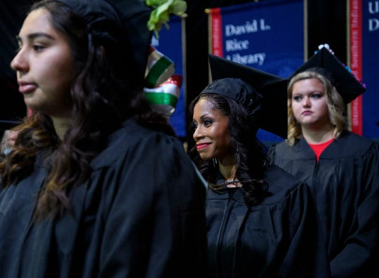 University of Southern Indiana graduates Jennifer Carapia, from left, Tiffany Coles, Kayley Conway wait in line to receive their diplomas during the Romain College of Business and College of Liberal Arts ceremony held inside USI's Screaming Eagles Arena in Evansville, Ind., Saturday, Dec. 7, 2019. More than 690 students from 21 states and 10 countries received degrees from USI during the two ceremonies held on Saturday.