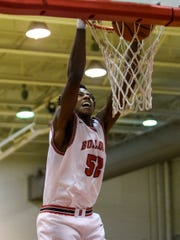 Bosse's Kiyron Powell (52) dunks during the second half of the season opener against the Terre Haute South Braves at Bosse High School in Evansville, Ind., Friday, Dec. 6, 2019.
