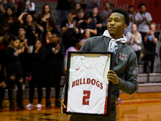 Former Bosse Bulldog Mekhi Lairy watches his jersey number be retired in a halftime ceremony during the season opening game against the Terre Haute South Vigo Braves at Bosse High School in Evansville, Friday evening, Dec. 6, 2019. He broke the city's all-time scoring record in 2018 and currently plays for Miami (Ohio) Redhawks.