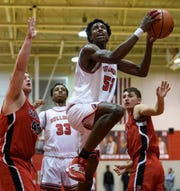 Bosse's Kiyron Powell (52) drives to the net during the season opener against the Terre Haute South Vigo Braves at Evansville's Bosse High School, Friday evening, Dec. 6, 2019. The Bulldogs defeated the Braves, 52-39.
