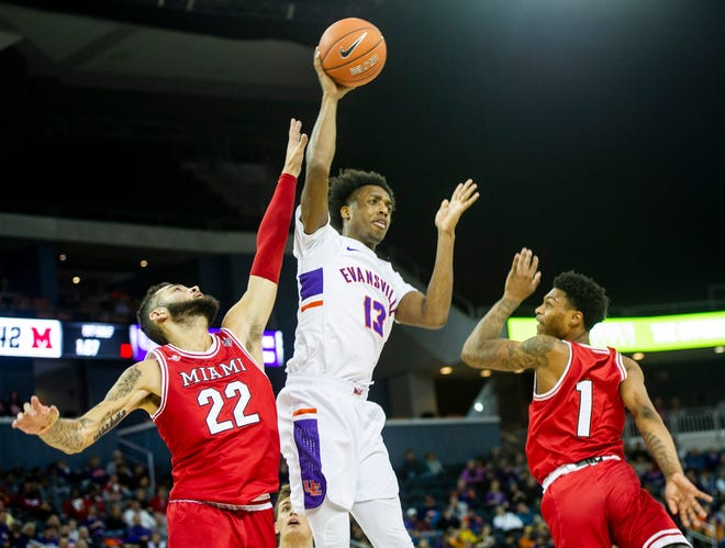 Evansville's DeAndre Williams (13) fakes out Miami University's defense before passing the ball at the UE vs Miami game at the Ford Center in Evansville, Saturday, Dec. 7, 2019.