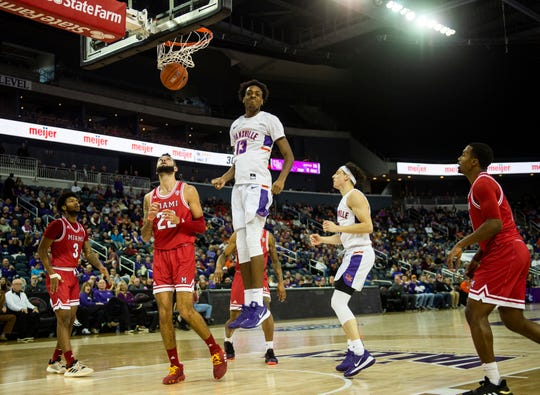 After scoring, Evansville's DeAndre Williams (13) looks to the student section to celebrate before his feet touch the ground the UE vs Miami game at the Ford Center in Evansville, Saturday, Dec. 7, 2019.