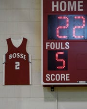 Former Bosse player Mekhi Lairy's jersey is displayed for all to see in the the Bosse High School gymnasium following the jersey retirement ceremony, Friday evening, Dec. 6, 2019. Lairy broke the city's all-time scoring record in 2018 and currently plays for the Miami (Ohio) Redhawks.