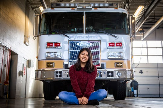 Halle Burke is pictured in front of a fire truck inside of Westminster Fire Station 2 on Saturday in Westminster. Halle was surrendered as an infant and now works to advocate for Colorado's Safe Haven law.