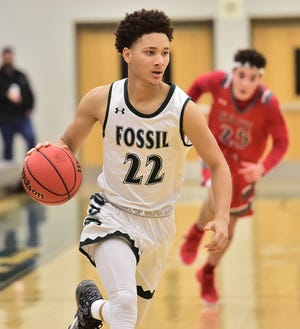 Fossil Ridge High School boys basketball player Micaiah Smith drives toward the basket during a game against Denver East on Friday, Dec. 6, 2019, in the Gojo Sports Tip-Off Classic at Fossil Ridge.