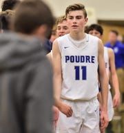 Rhys Travis leads Poudre High School's boys basketball team through the postgame handshake line following a loss to Dakota Ridge on Friday, Dec. 6, 2019, in the Gojo Sports Tip-Off Classic at Fossil Ridge.