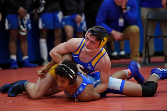 Eastside's Riley Augustine wrestles Fort Dorchester's Donny Greer in the 152 lb weight division. Augustine won by pin. Eastside hosted the Worksmart Southern Slam wrestling tournament Friday, Dec. 6, 2019.