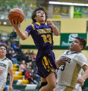 Hay-Lodgepole's Isaiah Denny attempts a layup over Heart Butte's Marcus Rutherford on Friday night at the 2019 Native American Basketball Classic in the CMR Fieldhouse.