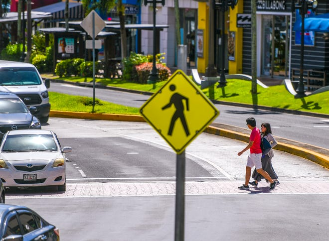 Tourist take in the sights and shopping in Tumon in this Dec. 7, 2019, file photo. Guam tour package sales with major companies are open, beginning at an April 1 departure date for most. PDN FILE PHOTO