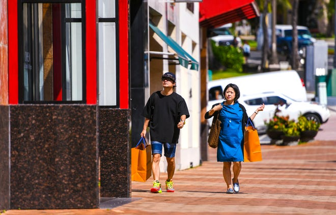 Tourists take in the sights and shopping in Tumon on Dec. 7, 2019. The government of Guam has informed South Korea, Japan and Taiwan that tourists will be welcome beginning July 1.