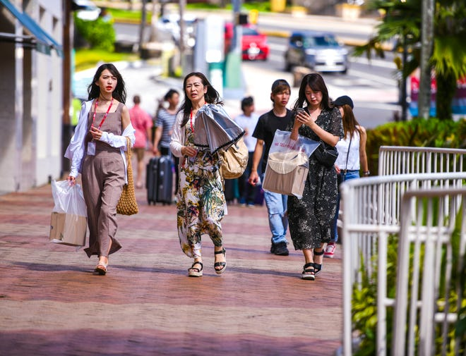 Tourist take in the sights and shopping in Tumon in this Dec. 7 file photo. The Guam Visitors Bureau announced the Tourism 2020 evaluation survey will end Dec. 31.