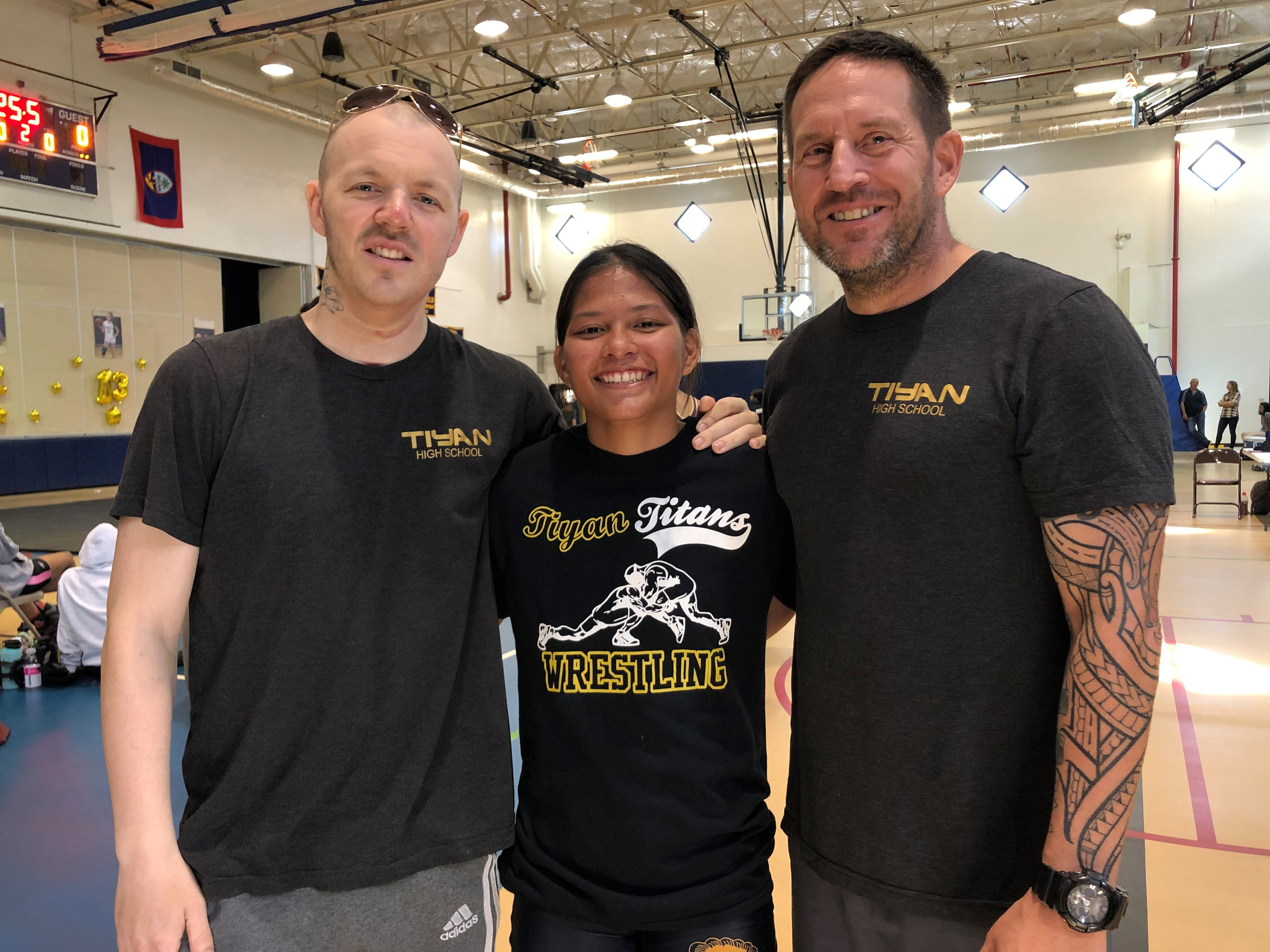 Nate Tully, left, is shown with wrestler Tiara Fernandez and Steve Bair during a meet in this file photo from November 2019. Tully died early Saturday morning of cancer.