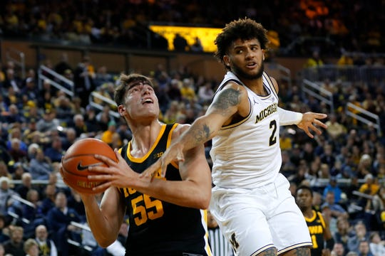 Garza's career night not enough in Hawkeyes' loss at Michigan